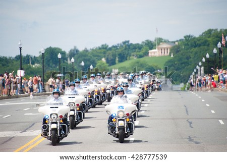WASHINGTON MAY 29: Police officers begin the ride at Rolling Thunder, a motorcycle rally to bring attention to POWs and MIAs of US-involved wars, on May 29, 2016 in Washington, DC.   - stock photo