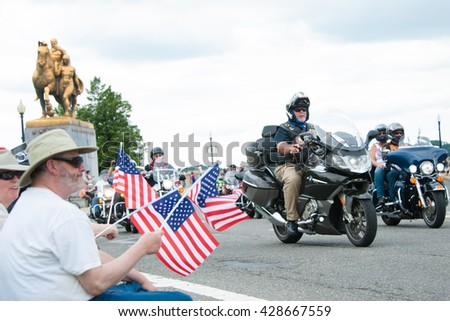 WASHINGTON â?? MAY 29: Riders take part in Rolling Thunder, a motorcycle rally to bring attention to POWs and MIAs of US-involved wars as bystanders show support on May 29, 2016 in Washington, DC.   - stock photo