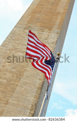 washington memorial with the american flag waving in front of it