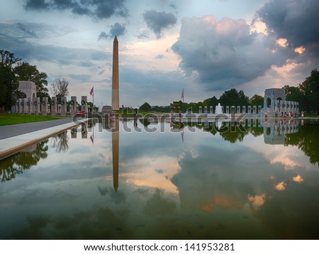 Washington Monument and the WWII memorial reflection in Washington DC. - stock photo