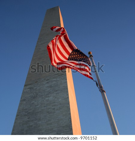 Washington Monument at dusk with American Flag