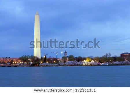 Washington Monument from tidal basin at dusk, DC - stock photo