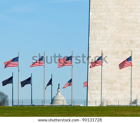 Washington Monument in DC on a clear winter day with Capitol dome in the distance - stock photo