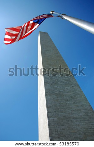 Washington Monument in Washington DC with flapping american flag on a flagpole - stock photo