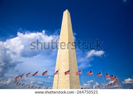 Washington Monument with american flags, Washington DC - stock photo