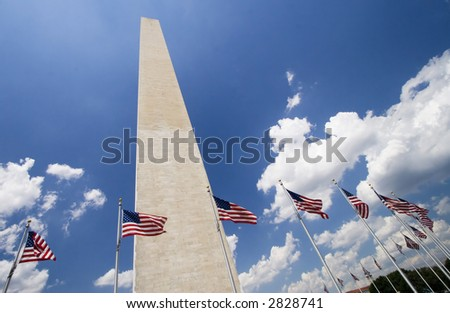 Washington Monument with flags - stock photo