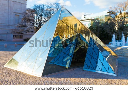 WASHINGTON - NOV 26: The pyramid of the National Gallery of Art pictured on November 26, 2010, in Washington, Maryland (USA). Established in 1937, it is one of the largest in USA. - stock photo