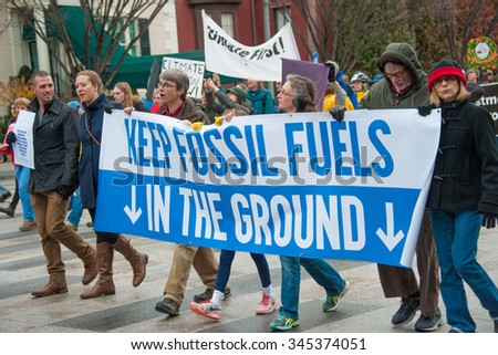 WASHINGTON - NOVEMBER 29:  Marchers take part in the Global Climate March in Washington, DC on November 29, 2015, the eve of the United Nations Climate Change Conference in Paris. - stock photo
