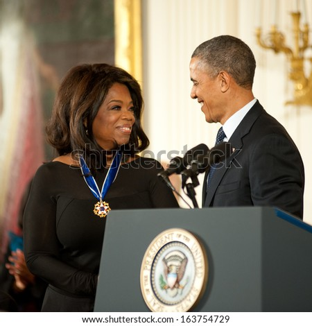 Washington -Â?Â? November 20: Oprah Winfrey receives the Presidential Medal of Freedom at a ceremony at The White House on November 20, 2013 in Washington, DC.  - stock photo