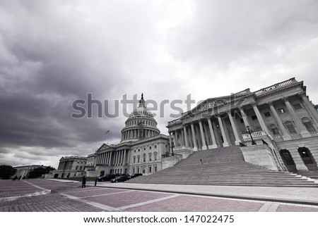 WASHINGTON-OCT 18:Capitol in the bad weather at wide angle in Washington dc on oct 18 2012. US Government shutdown in 2013, Congress failed to enact legislation appropriating fund for fiscal year 2014 - stock photo