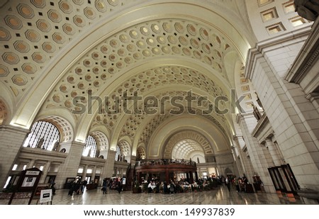 WASHINGTON, OCT 26: the pedestrians walk through the union train station in washington on 26 oct 2010. it is a major train station, rail hub, and leisure destination, by Harry Weese's design  - stock photo