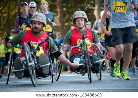 WASHINGTON - OCTOBER 27: A blind amputee competes in the Marine Corps Marathon on October 27, 2013 in Washington, DC - stock photo