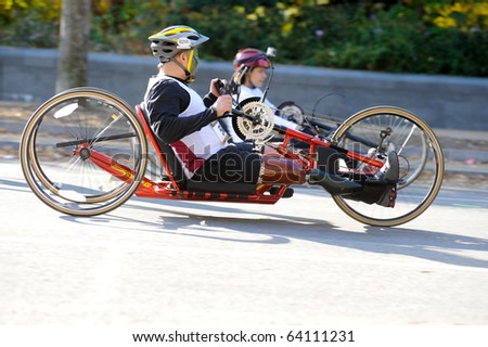 WASHINGTON- OCTOBER 31: A hand-cyclist competes in the Marine Corps Marathon on October 31, 2010 in Washington, D.C. - stock photo
