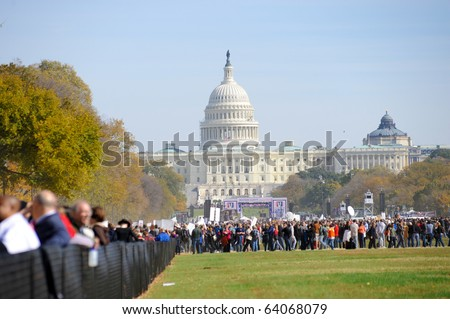 WASHINGTON - OCTOBER 30: Participants gather at the Rally to Restore Sanity and/or Fear on the National Mall on October 30, 2010 in Washington. - stock photo