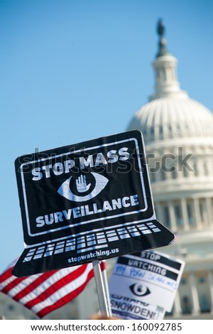 WASHINGTON - OCTOBER 26: Signs displayed during a rally against mass surveillance organized by the group Stop Watching Us in Washington, DC on October 26, 2013. - stock photo