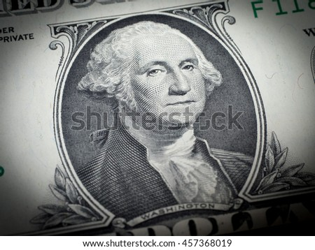 Washington's face on a dollar bill (Focus on face)