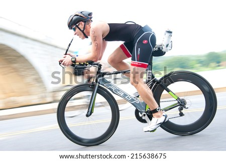 WASHINGTON - SEPTEMBER 7: A cyclist competes in the Nation's Triathlon on September 7, 2014 in Washington, D.C.