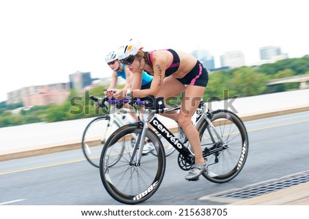 WASHINGTON - SEPTEMBER 7: A cyclist competes in the Nation's Triathlon on September 7, 2014 in Washington, D.C. - stock photo
