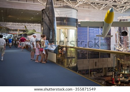 WASHINGTON, USA - AUG 26, 2014: Many visitors in National Air and Space Museum. - stock photo