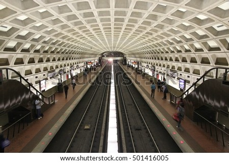WASHINGTON, USA - JUNE 14, 2013: People board subway train in Washington. With 212 million annual rides in 2012 Washington Metro is the 3rd busiest rapid transit system in the USA.
