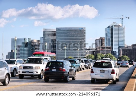 WASHINGTON, USA - JUNE 14, 2013: People drive in downtown Washington, DC. 65 percent of households in Washington DC own a car. - stock photo