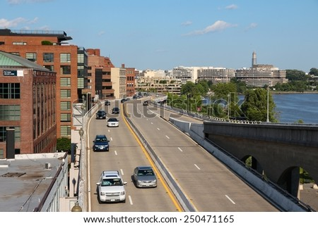 WASHINGTON, USA - JUNE 14, 2013: People drive Whitehurst Freeway in Washington DC. 646 thousand people live in Washington DC (2013) making it the 23rd most populous US city. - stock photo