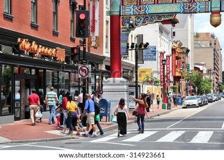 WASHINGTON, USA - JUNE 14, 2013: People visit Chinatown in Washington, DC, USA. Chinese minority of about 3,000 people lives here.