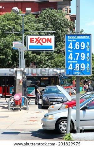 WASHINGTON, USA - JUNE 14, 2013: People visit Exxon gas station in Washington, DC, USA. ExxonMobil is the 3rd largest company in the world by revenue (420 billion USD in 2013). - stock photo