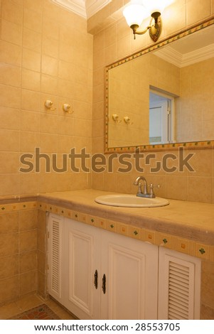 washroom interior,mirror and marble top washstand