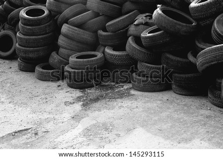 Waste car tires. Old used car tires stack. - stock photo