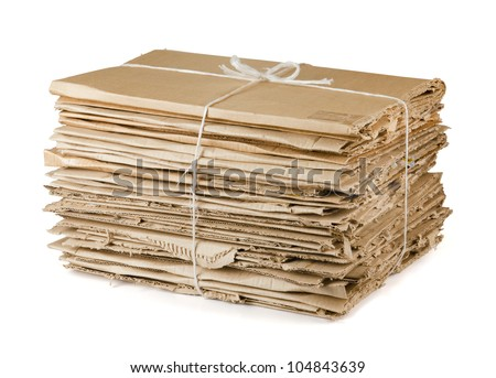 Waste cardboard bundle for recycling isolated on white - stock photo