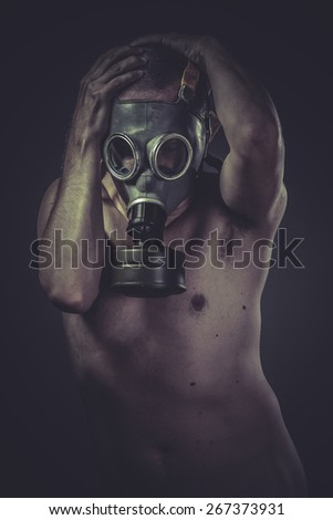 Waste, concept of risk of contamination, naked man with gas mask