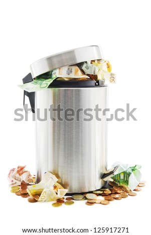Waste of money concept with waste money in and around a trash can on white - stock photo