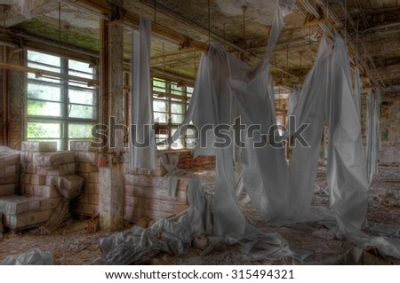 Waste paper in an abandoned paper mill - stock photo