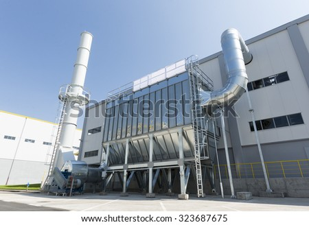 Waste-to-energy or energy-from-waste is the process of generating energy in the form of electricity or heat from the primary treatment of waste. Environmentally friendly, environment-friendly. Outside - stock photo