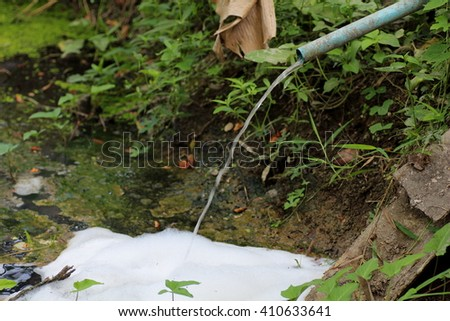 Waste water into the canal, pollute the water, Dirty water. Dangerous bacteriological situation - stock photo