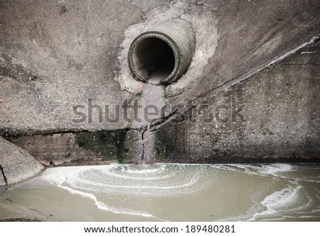 waste water pipe or drainage polluting environment - stock photo