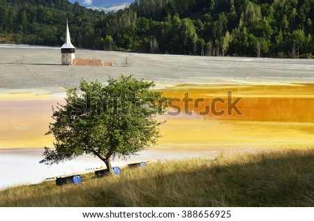 Waste water pollution of a copper mine. Geamana, Rosia Montana, Romania - stock photo