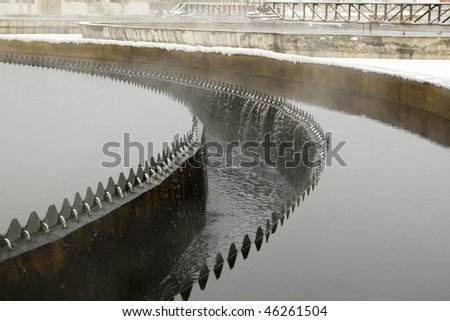 Waste-water treatment at winter time - stock photo