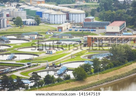 Waste water treatment plant - groups of storage tanks with waste water - stock photo