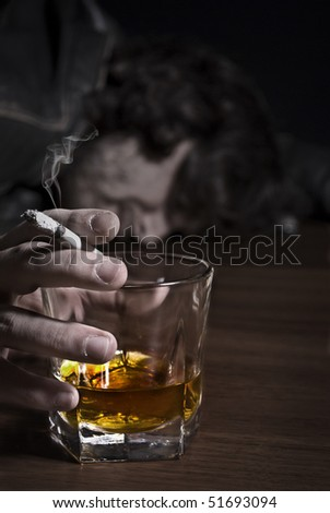 Wasted on the bar after a night of drinking. - stock photo