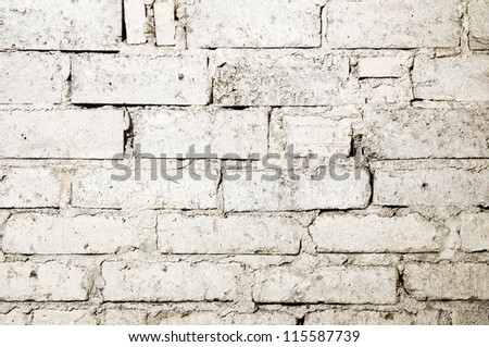 Wasted white brick wall background - stock photo