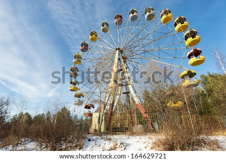 Wasteland and abandoned Ferris wheel, Pervouralsk, Urals, Russia - stock photo