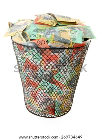 Wastepaper basket filled with Australian Money - stock photo
