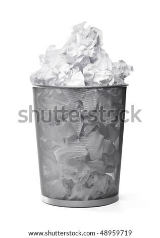 Wastepaper basket filled with crumpled papers