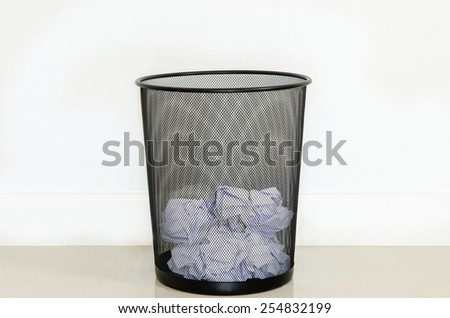 wastepaper in the recycle bin on the floor - stock photo