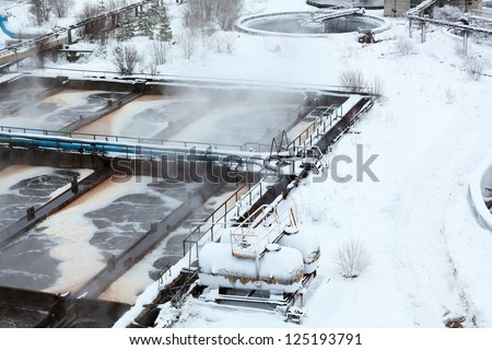Wastewater treatment plant and tanks with sulfuric acid - stock photo