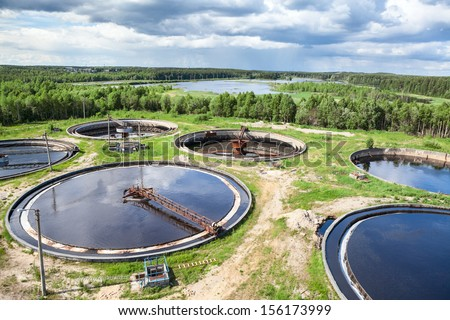 Wastewater treatment plant is an industrial structure designed to remove biological or chemical waste products from water - stock photo