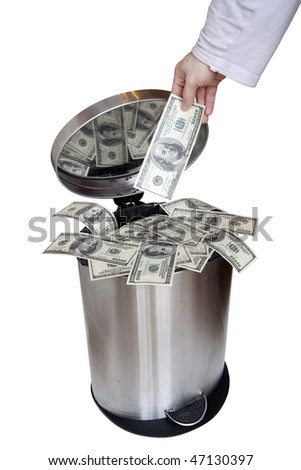 Wasting money - dollar bills in trashcan - stock photo