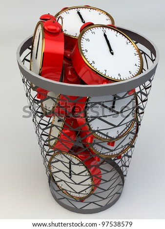 Wasting time concept: alarm clocks in the trash - stock photo